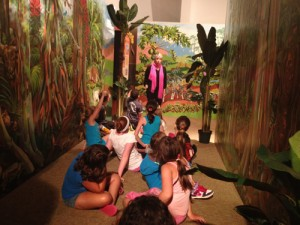 The very artist of our rainforest mural telling stories and answering questions in the exhibit.