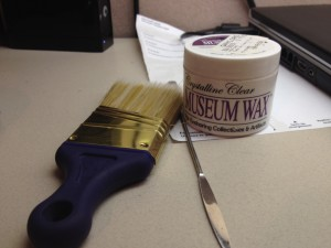 The brush is for cleaning the plastic and display base, the fancy wax for securing the plastic, and the spatula, while a pretty multifaceted tool when working in archives, helps secure the plastic as well.