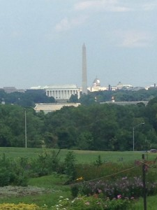View from the north side of Arlington National Cemetery. You can see the Lincoln Memorial, the Washington Monument, and the Capital Building, all in a row along the National Mall