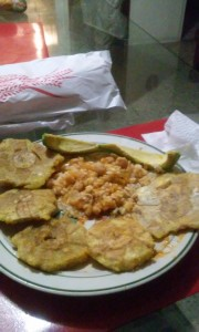 This is some delicous traditional food I ate this weekend The yellow things are called Tostones which are green fried plantains in the middle is whire rice and Habichuela's con salsa not slalsa like with tortilla chips but a sauce made with tomato's and sofrito